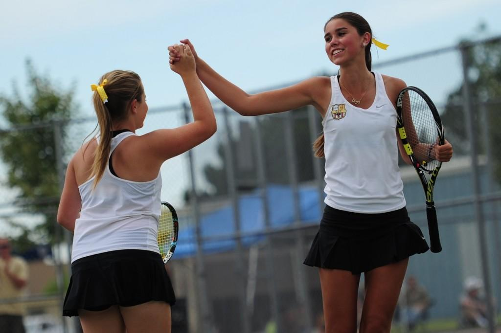 Girls tennis takes first state title in school history