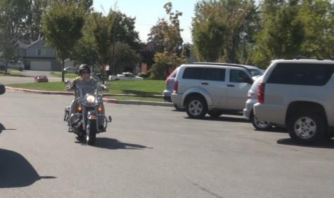 Mr. Swanson riding around on his Harley Davidson.