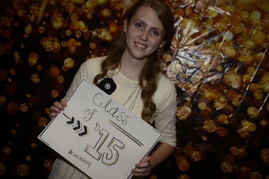 Senior+Hannah+Wilkinson+gets+picture+taken+at+Homecoming+dance.+