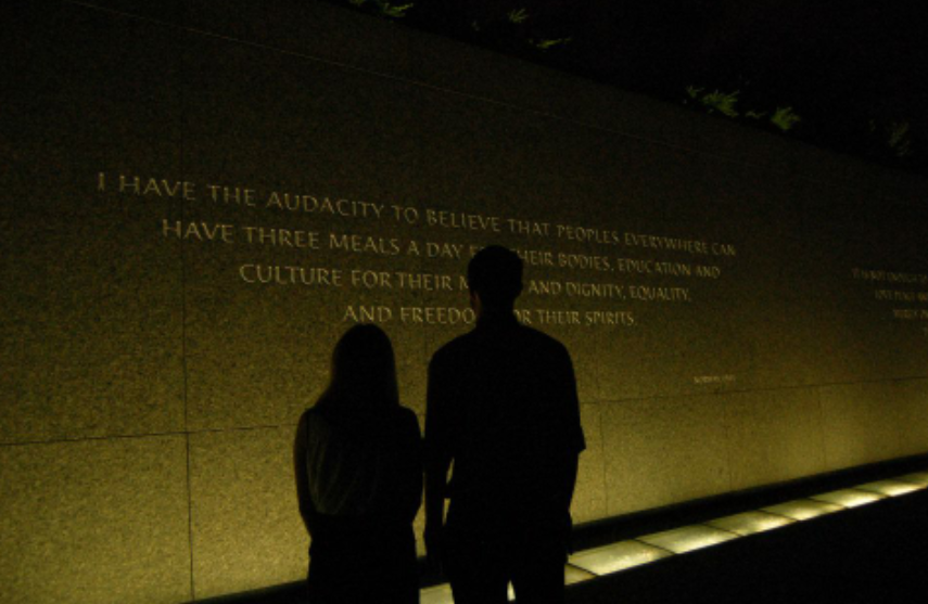 Aziza Cunningham, representative from Tennessee, and me reading quotes by Martin Luther King, Jr. engraved in the granite wall surrounding his monument in Washington, D.C. Photo by Camden Metheny, 2015 representative from Arkansas