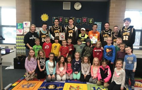 Boys basketball brings books to local elementary