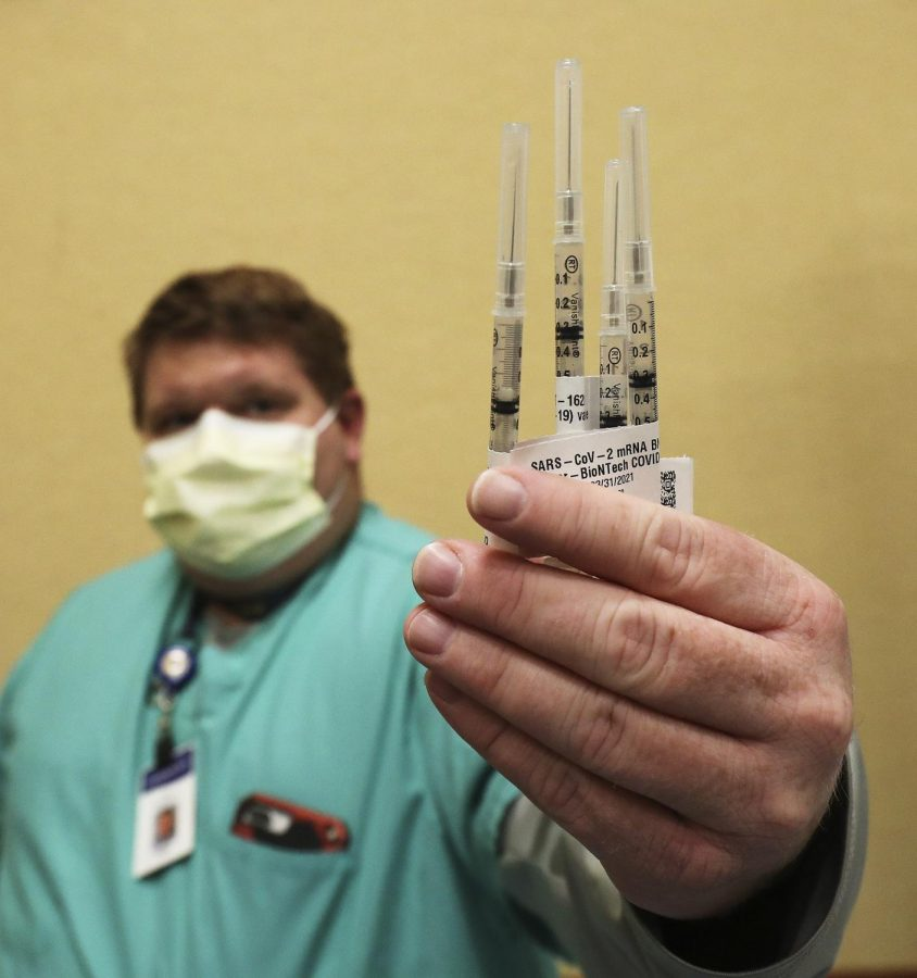 Intermountain Healthcare employee displays the COVID-19 vaccine.
