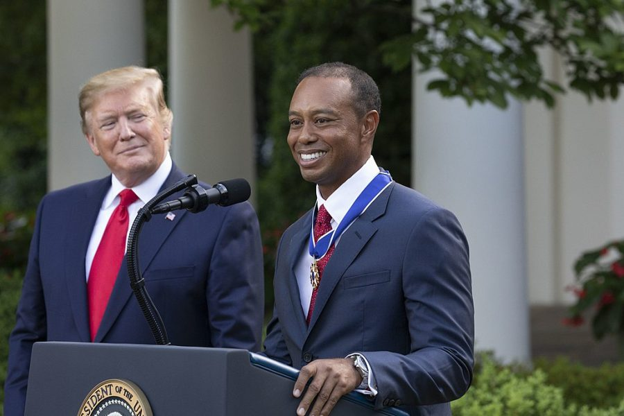Tiger Woods is presented with the Medal of Freedom by former President Donald Trump