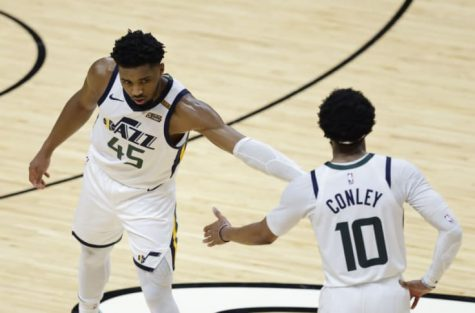 Donovan Mitchell (45) and Mike Conley (10) high five.